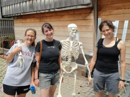 Program Administrator with two interns and model skeleton used for anatomical reference in classes