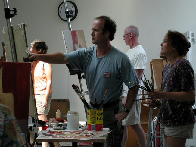 Education at PAAM, painting teacher demonstrates to student